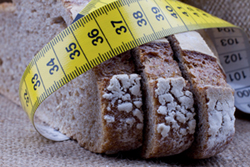 Measuring tape wrapped around slices of bread