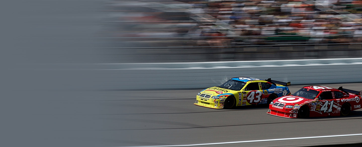 Two cars racing to the finish line at Kansas Speedway.