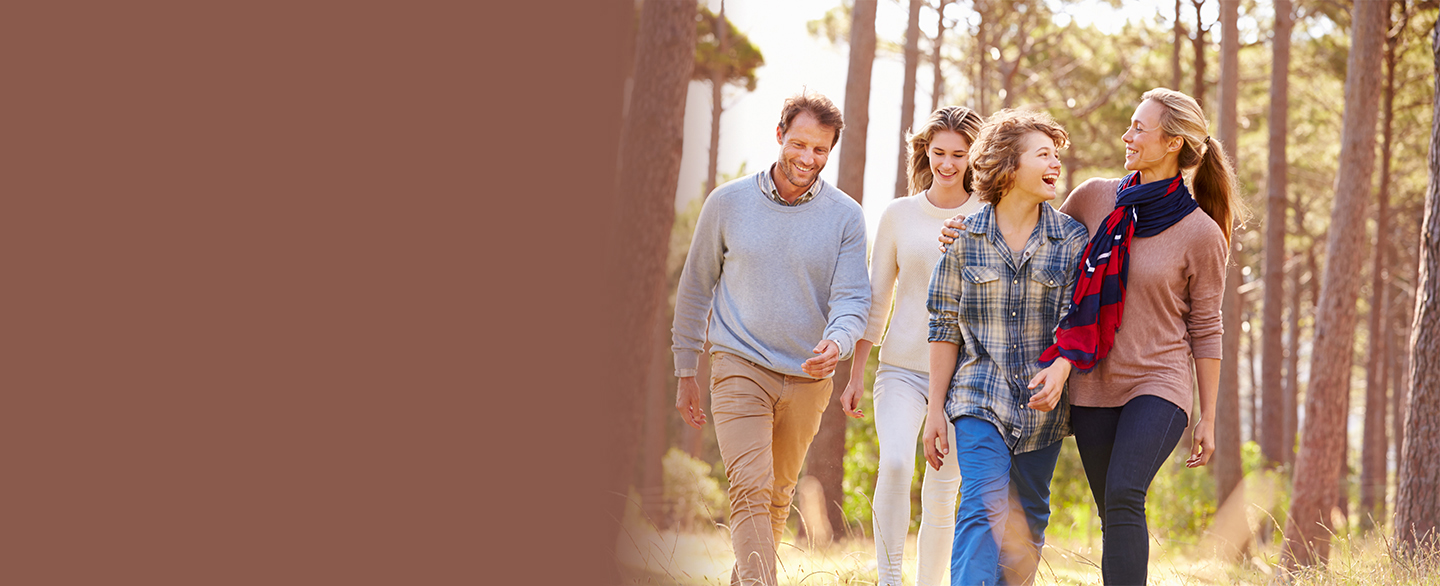 A family walking through a wooded area.