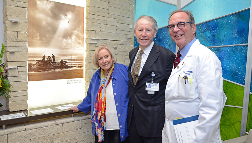Mary and William Reed, MD and cardiologist Charles Porter, MD in front of Bell Sanctuary.