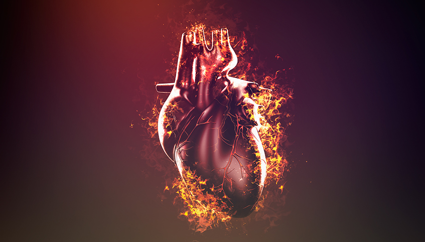 3D illustration of human heart surrounded in flames.