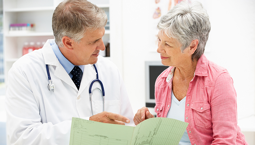 Doctor going over chart with patient.