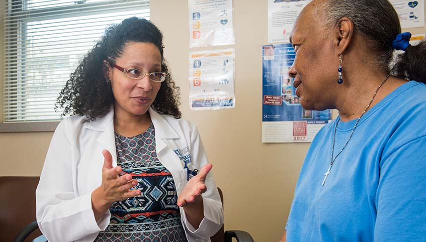 Epilepsy patient Peggy Ann Bell with Dr. Ulloa.