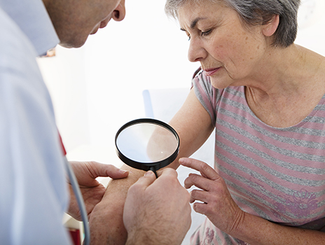 Women at dermatology appointment.