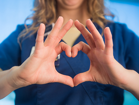 Nurse's hands in heart shape.