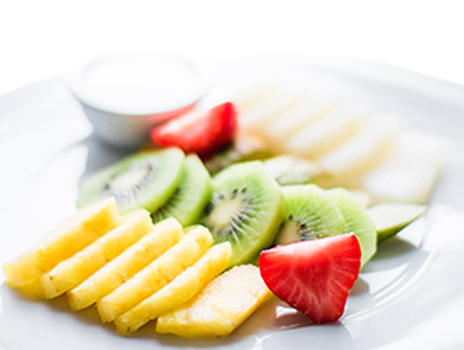 Sliced fruit on a plate.