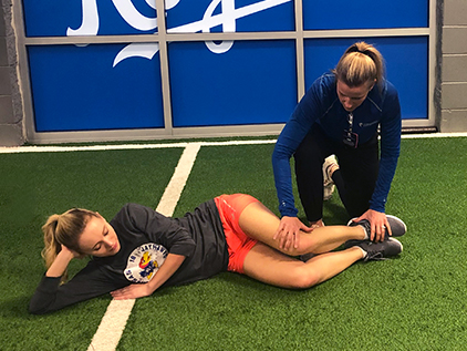 Krista Logan participating in an ACL injury reduction class.
