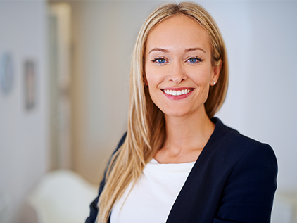 Woman dressed in business professional clothing.