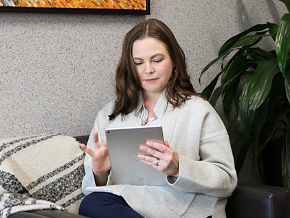 Woman using an iPad.