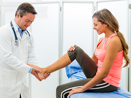 Doctor examining patient's foot and ankle.